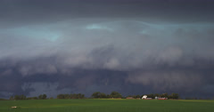 Dark altostratus clouds over a South Dakota farm Stock Footage