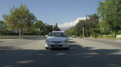 Rear view of a Driving Plate: Car travels on Lake Avenue in Pasadena, California Stock Footage