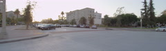 Rear view of a Driving Plate: Car makes a loop on the forecourt of City Hall in Stock Footage
