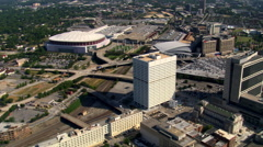 Flying north past Georgia Dome and GWCC in Atlanta. Shot in 2007. - stock footage