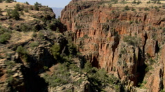 Flying through a red rock canyon - stock footage