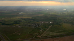 Flight over a Texas landscape where slanting evening rays sparkle on pools of - stock footage
