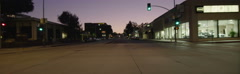 Front view of a Driving Plate: Car travels at dusk on West Colorado Boulevard in Stock Footage