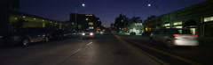 Rear view of a Driving Plate: Car travels at twilight on West Colorado Boulevard Stock Footage