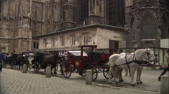 Horse-drawn carriages in Stephansplatz, Vienna Stock Footage