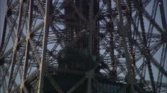 Close-up ascending scan of girders of the Eiffel Tower, Paris - stock footage