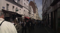 People walking on the Rue du Mont Cenis, Paris Stock Footage