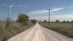 Wind turbines along a lonely rural road Stock Footage