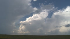 Time-lapse stormclouds rushing over a prairie landscape Stock Footage