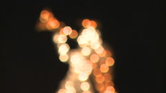 Soft-focus golden hexagons resolving into an Illuminated angel with trumpet Stock Footage
