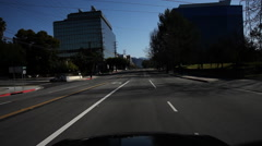 Driving northeast on West Alameda Avenue in Burbank, California; Disney Studios Stock Footage