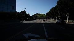 Turning onto Forest Lawn Drive in Hollywood Hills, Los Angeles Stock Footage