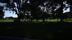 Driving past Forest Lawn Memorial Park and Mortuary in Hollywood Hills, Los Stock Footage