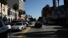 Driving on Hollywood Boulevard, past Guinness Museum, old Christie Hotel, and Stock Footage