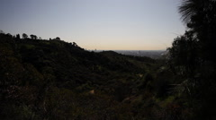 Griffith Observatory atop Mount Hollywood with Los Angeles in distance Stock Footage