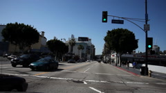 Driving through the 6100 block of Hollywood Boulevard; Walk of Fame on sidewalk - stock footage