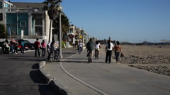 Cyclists and pedestrians on bike path at Santa Monica  Beach Stock Footage