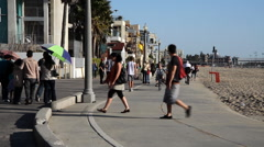 People on a bike path at Santa Monica Pier Stock Footage