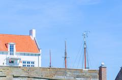 Small house at a harbor - stock photo