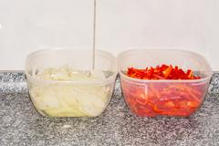 Two bowls with peppers and onions Stock Photos
