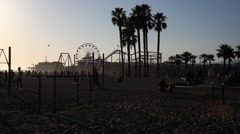 Playground at Muscle Beach in evening light; Santa Monica Pier in background - stock footage