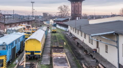 View of The Railway Station's Depot Roof Buildings Old Wagons are Standing Stock Footage