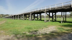 Pan left to right along deck of Prince Alfred Bridge, Gundagai Stock Footage