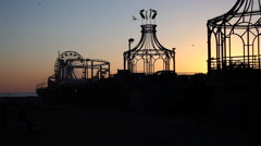 Santa Monica Pier silhouetted at sunset Stock Footage