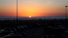 Crowded parking lot behind Santa Monica Beach at sunset Stock Footage