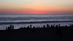 Silhouettes of people enjoying Santa Monica Beach at sunset - stock footage