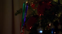 Close-up ornaments on a Christmas tree coming into focus - stock footage