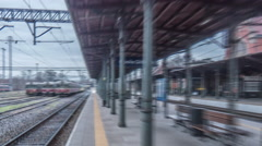 People Under The Roof at Station Red Train Arrives Train is Leaving Wagons Stock Footage