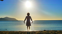 Sea. Sunrise. The girl on the beach greets the sunrise Stock Footage