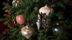 Rack focus ornaments on a Christmas tree - stock footage