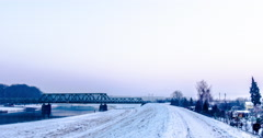 Man is Walking at The River by Snow Railway Bridge Hyperlapse Titelapse Small Stock Footage
