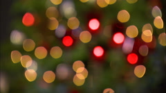 Right pan over soft-focus lights on a Christmas tree - stock footage