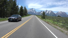 Driving POV towards Grand Teton NP Mountains fast motion HD Stock Footage