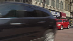 Left Front Three Quarter view of a Driving Plate: Car travels on South Broadway Stock Footage