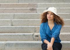 Beautiful woman sitting alone on stairs Stock Photos