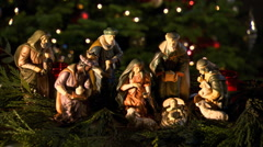 Close-up tabletop Nativity scene among evergreen foliage Stock Footage