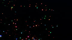 Zoom-out on a lighted outdoor Christmas tree at night Stock Footage