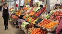 Customer at the counter to pick fruit and approaching seller Stock Footage