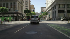 Front view of a Driving Plate: Car travels one block on South Spring Street in Stock Footage