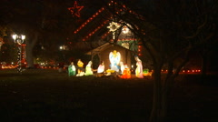 Zoom-in on an outdoor Nativity scene and a harp-playing angel Stock Footage