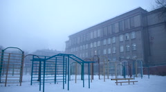 Grim playground in the mist of the old school - stock footage