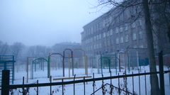 Grim playground in the mist of the old school Stock Footage