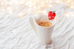 White cup of hot coffee with decorative heart and engagement diamond ring, sy Kuvituskuvat