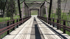 POV drive historic Hutchins Bridge Madison River Montana HD Stock Footage