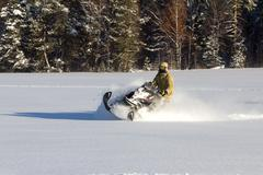 Athlete on a snowmobile - stock photo