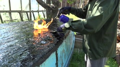 Hand repair surface with burner resin in construction site. 4K Stock Footage